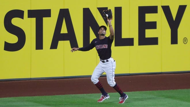 Cleveland Indians center fielder Oscar Mercado (35) gets under a fly ball hit by Kansas City Royals second baseman Whit Merrifield (15) during the eighth inning of the Indians' home opener against the Kansas City Royals at Progressive Field, Friday, July 24, 2020, in Cleveland, Ohio.