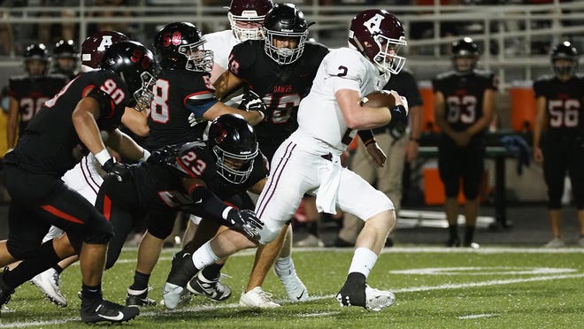 Austin High's Charles Wright breaks away from a pack of Bowie defenders for a touchdown run during the Maroons' 57-56 combeack win Thursday at Burger Stadium. Wright added six passing touchdowns in the victory.