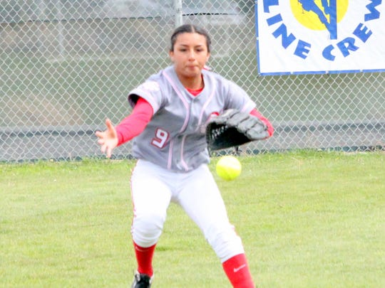 Cobre's Marisa Ray comes up on a ball sharply hit into left field during Friday's action against Silver.