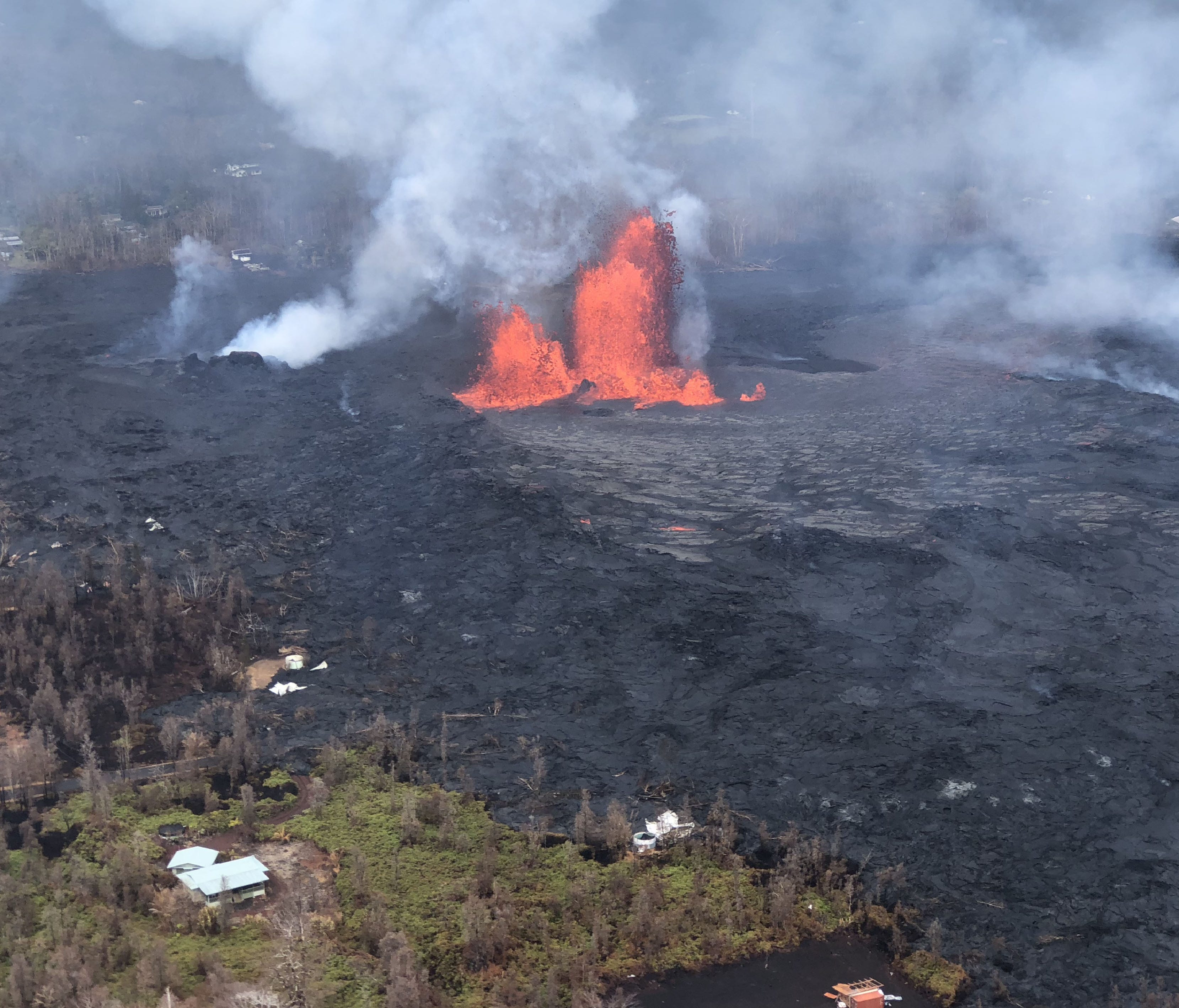 This image obtained May 30, 2018 from the US Geological Survey shows Fissure 8 reactivated on the afternoon of May 29,2018 when, at times, lava fountains were reaching heights of 200 feet and feeding a lava flow that advanced to the northeast at Kila