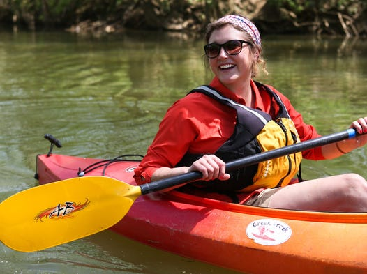 The Parklands of Floyds Fork communications director Ellen Doolittle has a laugh while floating down Floyds Fork on Monday. The Parklands of Floyds Fork offered canoe rentals on Derby weekend and is contracting with a company to offer canoe rentals through the warm weather season. May 5, 2014