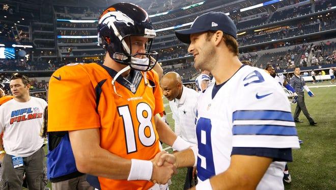 Former Denver Broncos quarterback Peyton Manning (18) meets with Dallas Cowboys quarterback Tony Romo (9) at AT&T Stadium in 2014. Denver is in need of a veteran quarterback such as Romo to join its roster, columnist Mark Knudson writes.