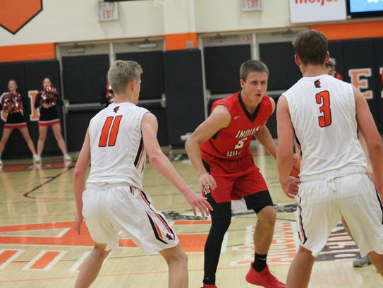 Indian Hill top scorer Colin Shaw is double-teamed