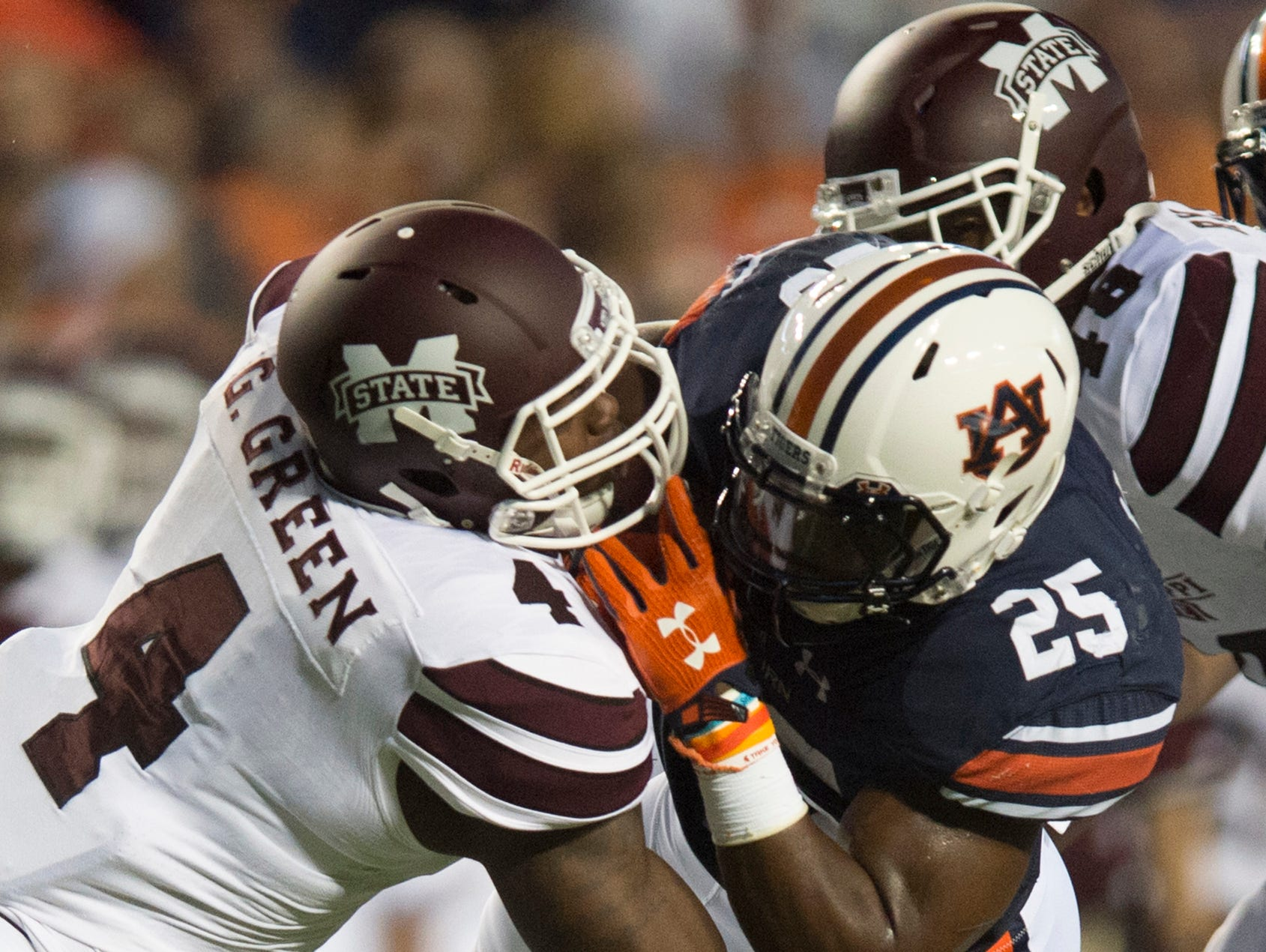 Mississippi State linebacker Gerri Green (4) tackles Auburn running back Peyton Barber (25) during the NCAA football game between Auburn and Mississippi State on Saturday, Sept. 26, 2015, at Jordan-Hare Stadium in Auburn, Ala. Albert Cesare / Advertiser