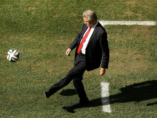 Switzerland's coach Ottmar Hitzfeld kicks a ball during the World Cup round of 16 soccer match between Argentina and Switzerland at the Itaquerao Stadium in Sao Paulo, Brazil, Tuesday, July 1, 2014. (AP Photo/Thanassis Stavrakis)