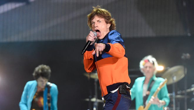 The Rolling Stones' Mick Jagger rush-released two new songs Thursday, 'Gotta Get a Grip' and 'England Lost.'