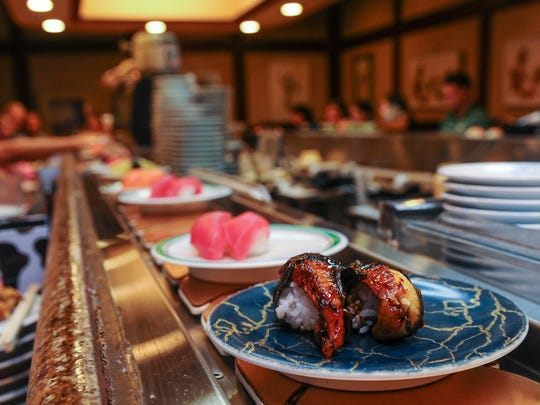 Prepared sushi travel along on a conveyor belt at the Rotary Sushi & BBQ restaurant in Tumon on July 6.Rick Cruz/PDN