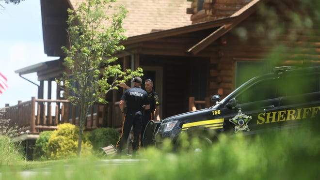 Two Sussex County sheriff's officers assigned to security detail are seen talking in the driveway of the Hampton home of Sussex County Sheriff Michael Strada on Monday afternoon.