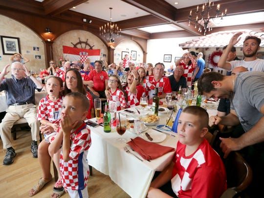 Fans of the Croatian soccer team react after France