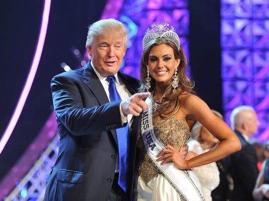 Donald Trump poses with Erin Brady after Brady won