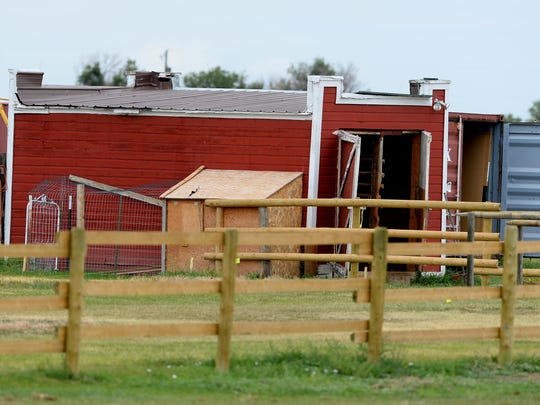 Red barn on the property at 5029 66th Ave. S.W. where the homicide investigation in the death Adam Petzack began in 2016.