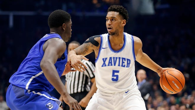 Xavier Musketeers guard Trevon Bluiett (5) dribbles outside the three-point line in the first half of the NCAA Big East Conference basketball game between the Xavier Musketeers and the Creighton Bluejays at the Cintas Center in Cincinnati on Saturday, Jan. 13, 2018.