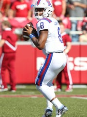 Louisiana Tech Bulldogs quarterback J'Mar Smith (8) drops back in the first half against the Arkansas Razorbacks at Donald W. Reynolds Razorback Stadium.