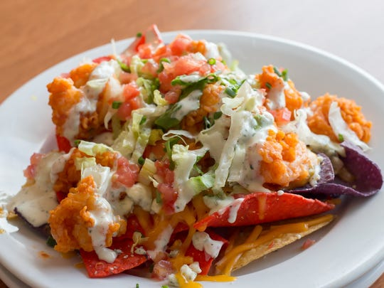 The appetizer menu at Capt'n Butcher's includes Buffalo shrimp nachos.