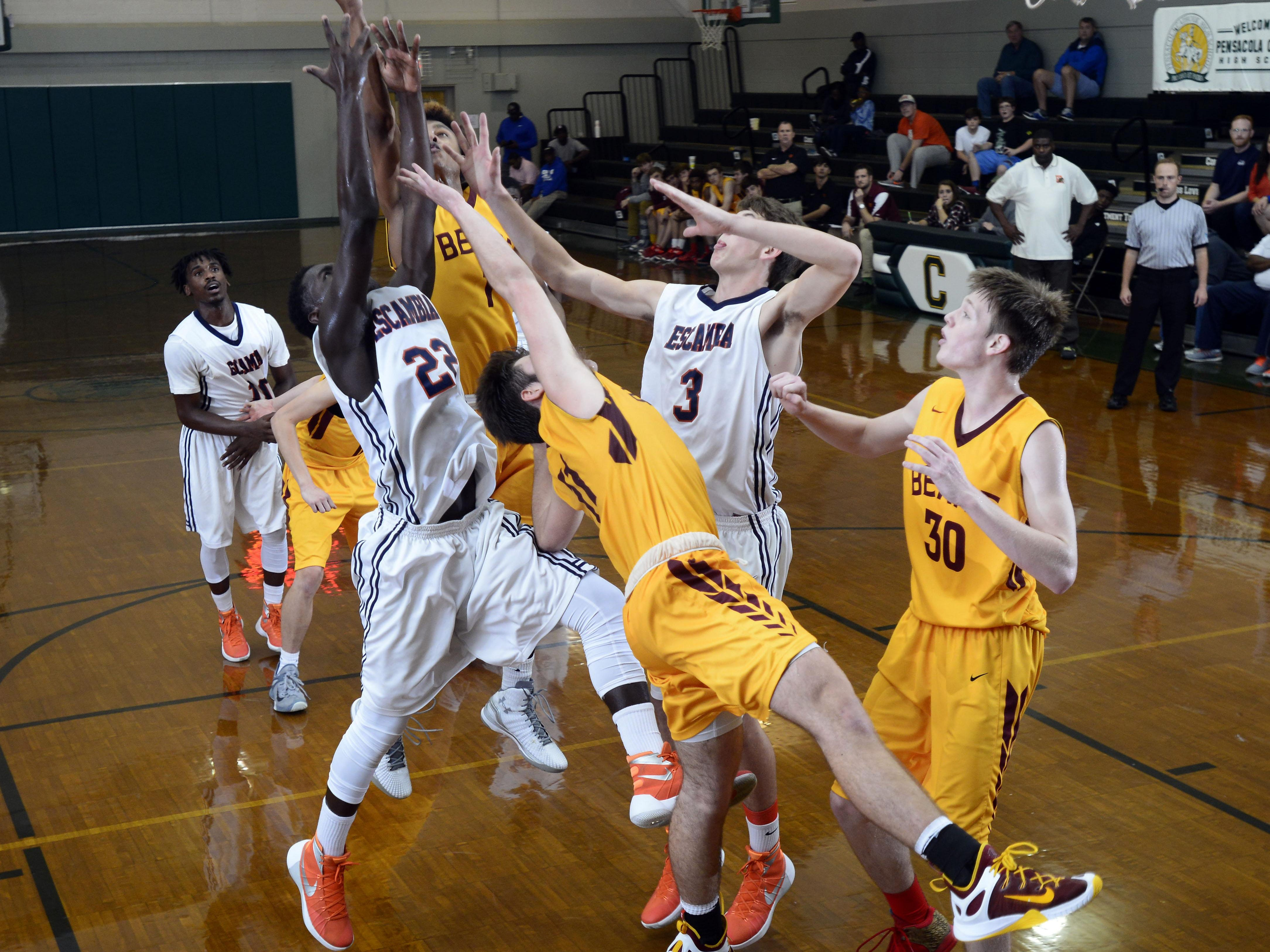 Escambia High School and Holy Innocents Episcopal players scramble for a rebound Wednesday during Catholic High School's fourth annaual Crusader Classic basketball tournament. Escambia fell to Holy Innocents 45-55 to take second place in the tournament.