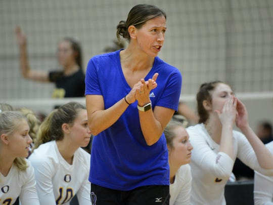 Oconomowoc coach Michelle Bruss cheers on her team in the championship match.