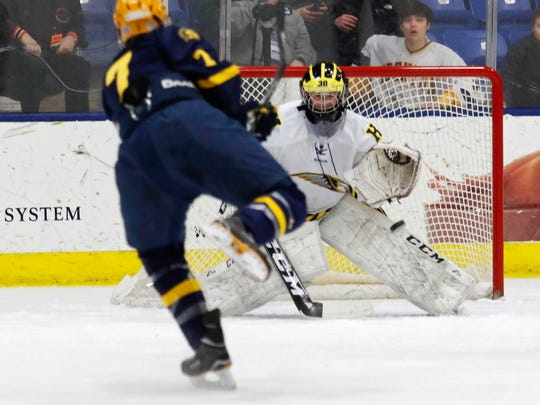 Hartland goalie Brett Tome, who had 27 saves, stares