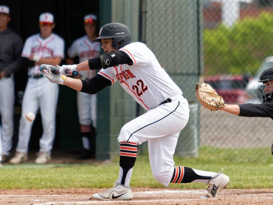 Brighton's Jackson Brenner lays down a bunt in a 3-0 victory over Howell in the district baseball championship game on Saturday, June 2, 2018.
