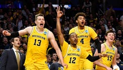 Michigan Wolverines forward Moritz Wagner (13) and