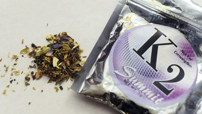 This Feb. 15, 2010, file photo, shows a package of K2 which contains herbs and spices sprayed with a synthetic compound chemically similar to THC, the psychoactive ingredient in marijuana.