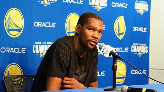 Mar 16, 2018; Oakland, CA, USA; Golden State Warriors forward Kevin Durant addresses the media regarding his incomplete rib cartilage fracture injury before the game between the Golden State Warriors and Sacramento Kings at Oracle Arena. Mandatory Credit: Kelley L Cox-USA TODAY Sports ORG XMIT: USATSI-363252 ORIG FILE ID:  20180316_jrs_ax5_102.jpg