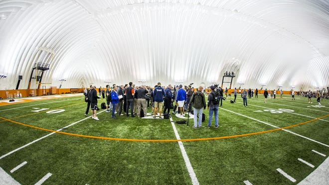 Former Texas football players work out in an attempt to impress NFL scouts during UT's 2018 pro timing day in the Bubble at Denius Fields. Could another bubble be in current players' future?