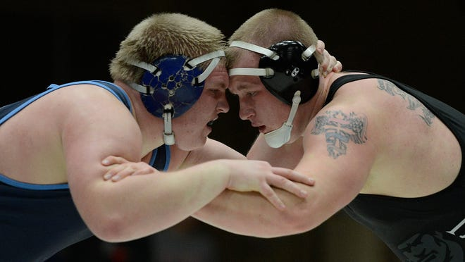Bay Port's Ryan Van De Walle and Pulaski's Hunter Micholicek face off in their 285-pound match during a January wrestling dual at Bay Port High School in Suamico. Van De Walle won the match.