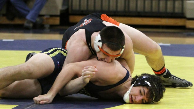 Brighton junior Luke Ready beat a pair of ranked opponents at 215 pounds to help the Bulldogs wrap up their first KLAA West title since 2012 on Wednesday night.