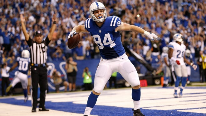 Indianapolis Colts tight end Jack Doyle (84) celebrates after catching the tying touchdown pass from quarterback Andrew Luck (12) against the Detroit Lions at Lucas Oil Stadium on Sept. 11, 2016.