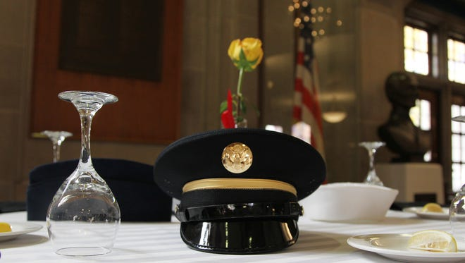 The Table of Remembrance at the Veterans Day ceremonies Friday, November 11, 2016, in the Great Hall of the Purdue Memorial Union.