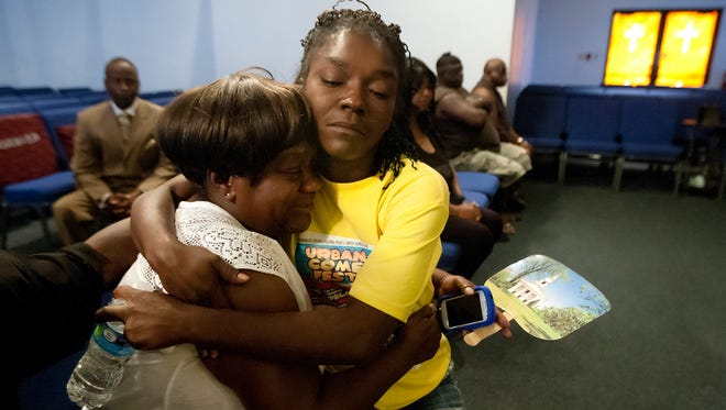 Toyetta Simpson, comforts her mother, Catherine Jackson, during the viewing of Simpson's son, Andrew Faust Jr., 5, on Friday at Mount Hermon Church in Fort Myers.