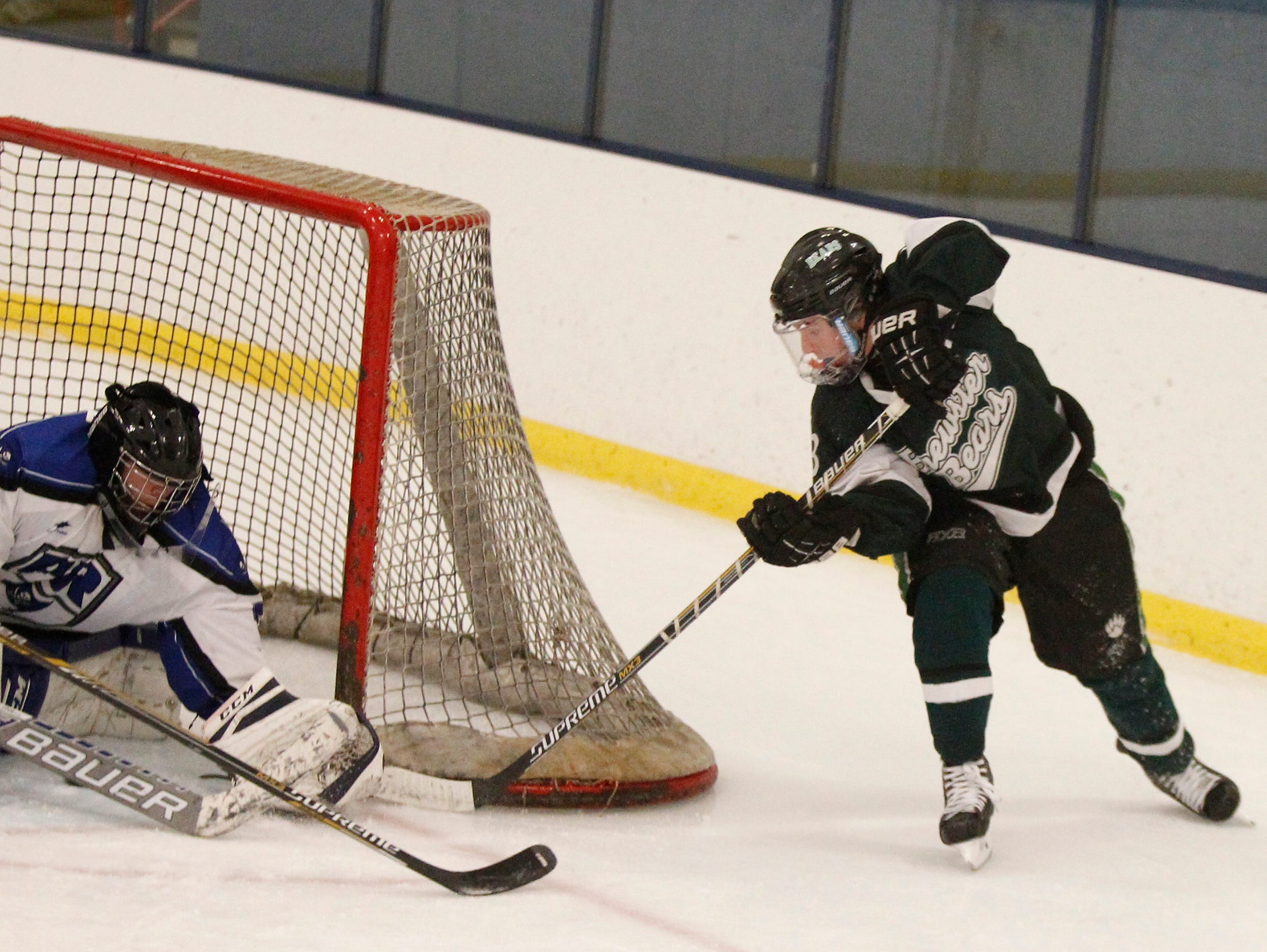 Brewster's Jason McNamara (12) gets in a wraparound shot on Pearl River goalie Darragh Keetley (32) during their 4-4 overtime tie game at Sport-O-Rama in Monsey on Saturday, Jan. 9, 2016.