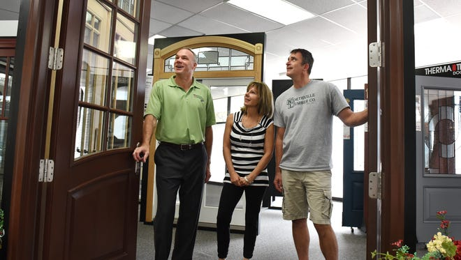 Northville Lumber Home Design Studio is enjoying its new digs at 22264 Novi Road (in the old Blockbuster store front). Employees Ray Mandle, Linda Bonell and Dan Wilber, right, check out some of their front door offerings.