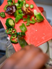 Faisa Omar adds chopped dates, green peppers and jalapenos