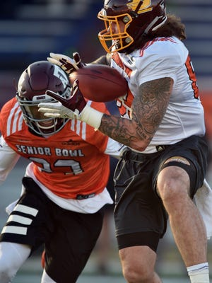 Jan 23, 2018; Mobile, AL, USA; Central Michigan tight end Tyler Conklin tries to catch a pass against Texas A&M safety Armani Watts during Senior Bowl practice at Ladd-Peebles Stadium.