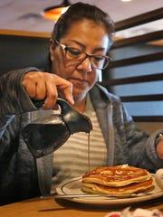 Lucero Rodriguez enjoys a short stack of pancakes at IHOP.