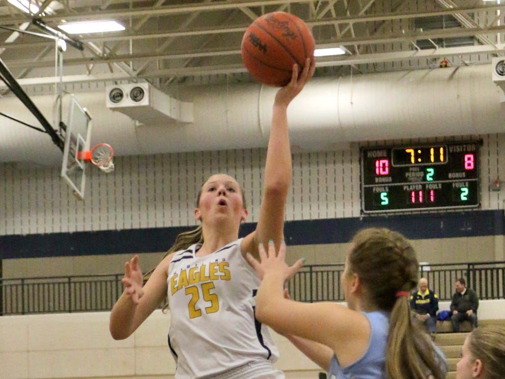 Lexey Tobel goes strong to the hoop in the first half Tuesday night. She finished with a team-high 16 points in Hartland's 50-38 win over Waterford Mott.