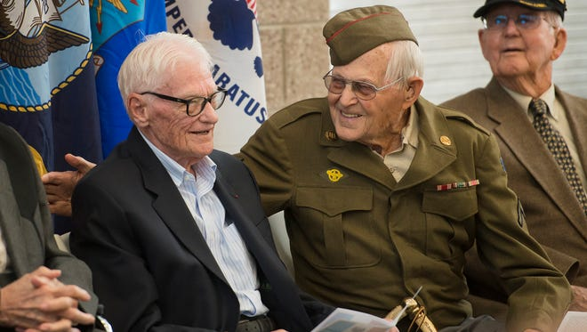 LeMoyne W. Anderson, left, shares a laugh with Richard W. Mann during a ceremony where the French government is bestowed the National Order of the The Legion of Honor to local vets who served in World War II on Wednesday at the Colorado National Guard Readiness Center in Windsor.