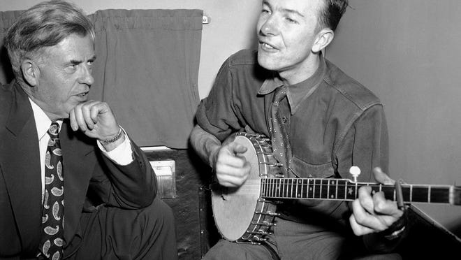 Progressive Party presidential candidate Henry A. Wallace, left, listens to Pete Seeger on a plane between Norfolk and Richmond, Va., in 1948.