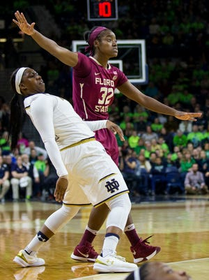 Notre Dame's Arike Ogunbowale (24) tries to put body english on a 3-point shot next to Florida State's Imani Wright (32) during the first half of an NCAA college basketball game Sunday, Feb. 26, 2017, in South Bend, Ind. Notre Dame won 79-61.
