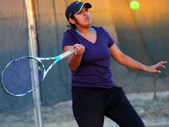 Alamogordo's Megan Sampath prepares to return a forehand shot during practice at the Oregon Courts.