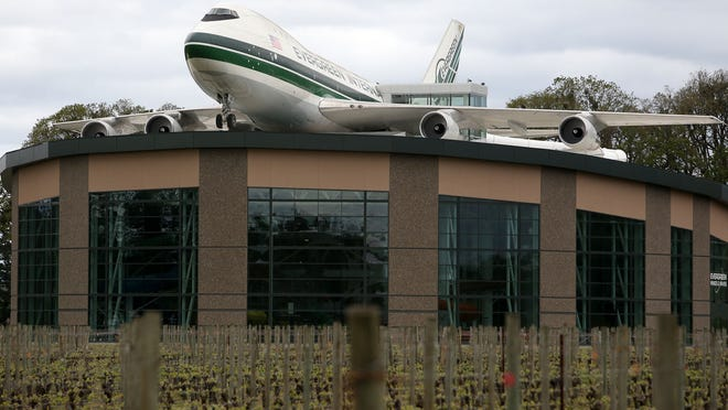 A Boeing 747 tops The Evergreen Wings and Waves Waterpark. The plane houses the beginning of four waterslides.
