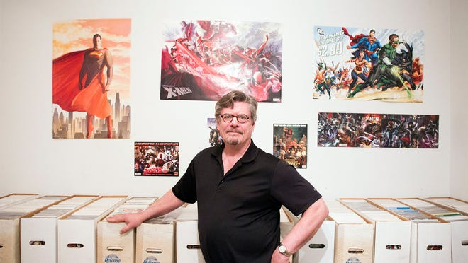 "Jerry Harrington poses with his comic books at his home on Friday, May 1, 2015. Harrington, who owns more than 20,000 comic books, teaches ""The History of American Comic Books"" through Kirkwood's Continuing Education program. David Scrivner / Iowa City Press-Citizen"