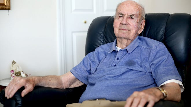 Oscar Specht, 98, an Army Air Corps pilot in World War II, sits in his home at Capitol Manor in West Salem on Thursday, May 7, 2015.