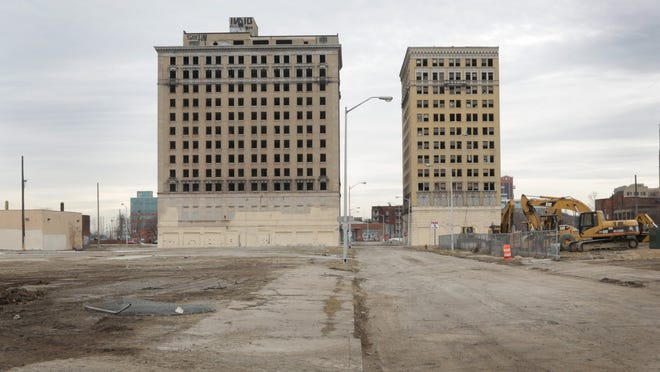 Ilitch Holdings is asking the Detroit Historic District Commission's permission to demolish the Park Avenue Hotel, left, to make room for the new arena. The Eddystone Hotel, right, will be refurbished.