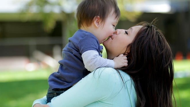 Destiney Xiong, 18, kisses her son, Benjamin Cruz, 1, at the Teen Parent Program, part of the Early College High School, at Chemeketa Community College in Salem on Thursday, May 7.