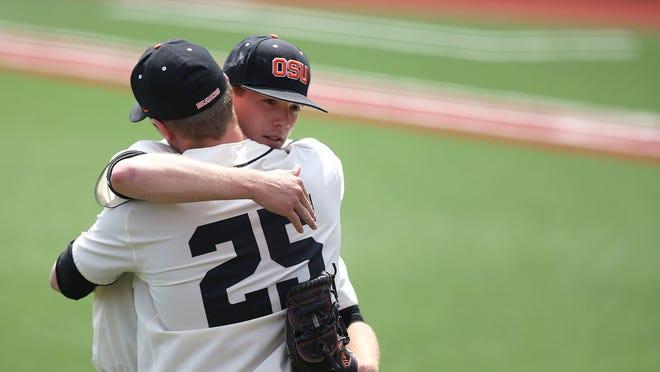 Oregon State's Travis Eckert hugs Drew Rasmussen after pitching against Utah on Sunday, May 10, 2015, in Corvallis, Ore.