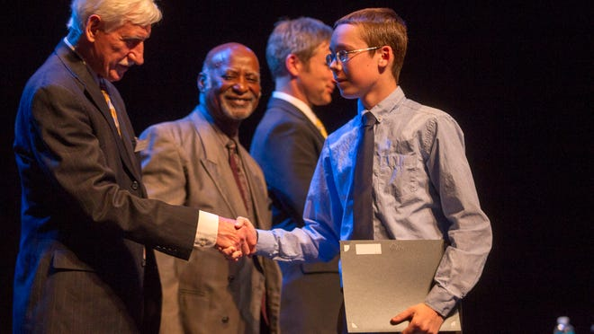 Joey Trom is honored during the Iowa City Human Rights Commission's Youth Awards at the Englert Theatre on Wednesday.