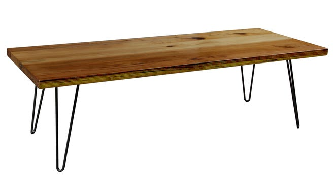 Hairpin coffee table by Workshop is made from lumber reclaimed from abandoned house in Detroit. It is available at Gardner-White.