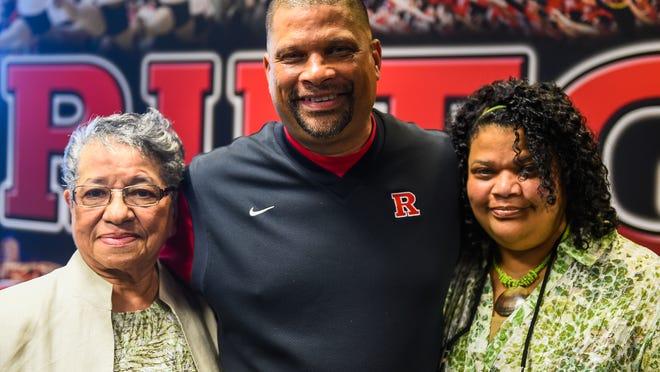 Rutgers men's basketball coach Eddie Jordan poses with his sister Natalie Jordan (right) and his mother Marguerite Jordan (left).